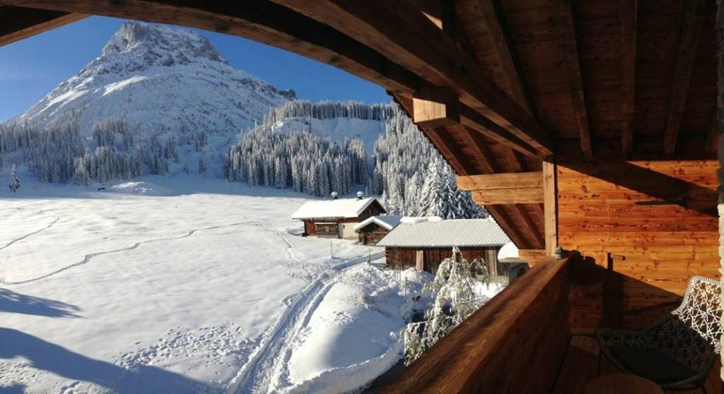 View of the snow-covered landscape on the Arlberg from the terrace at Lech Lodge